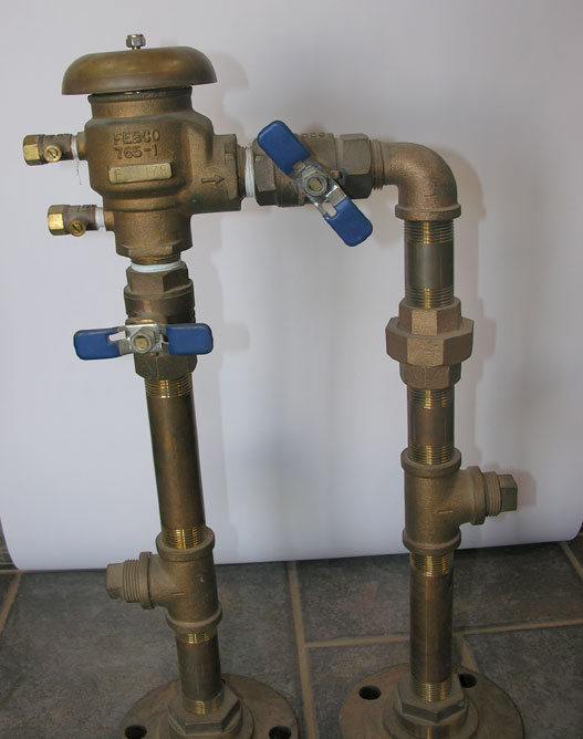 Figure 3a: Left Photo: Pressure vacuum backflow device (PVB)