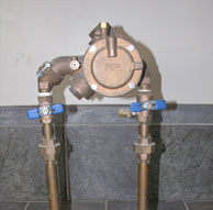 Right Photo – Reduced Pressure back flow device (RP). Blue handles designate