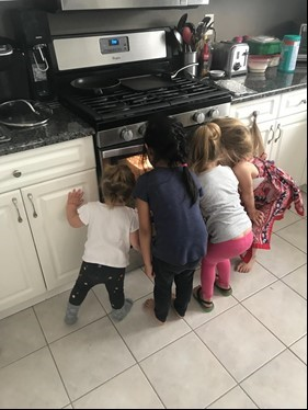 children watching oven