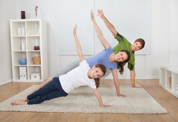family practicing yoga