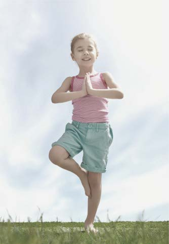 child doing tree yoga pose